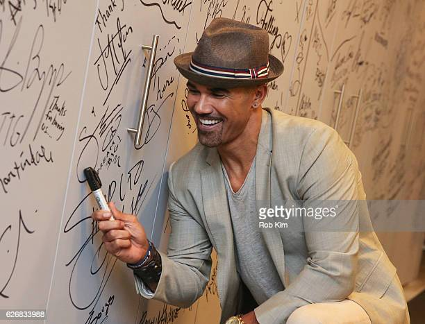 """The Bounce Back"""" cast member Shemar Moore signs his autograph at the Build Series at AOL HQ on November 30, 2016 in New York City."""