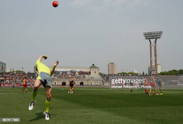 The boundary umpire throws the ball in during the 2017 AFL round 08 match between the Gold Coast Suns and Port Adelaide Power at Jiangwan Sports...