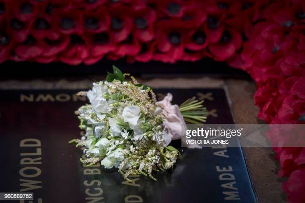 The bouquet of flowers carried by Meghan Markle during her wedding to Britain's Prince Harry Duke of Sussex at ST George's Chapel Windsor Castle is...