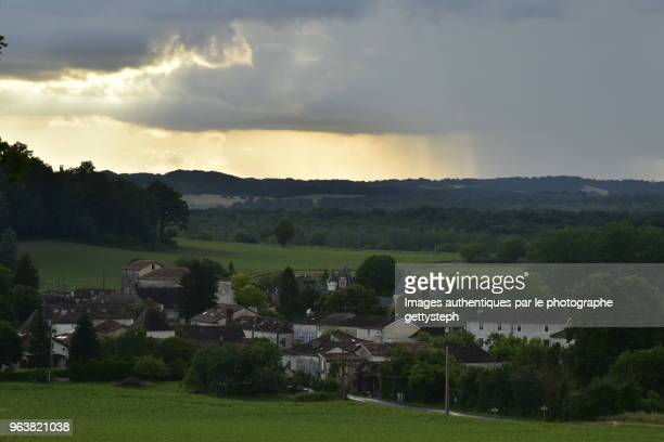 The bourg of Champagne under dark clouds in dusk