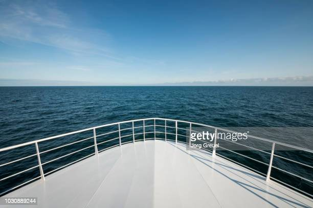 the bow of a ship in the north sea - railing stock pictures, royalty-free photos & images