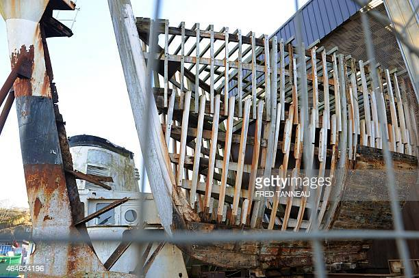 The bow of the former boat of French commandant Cousteau La Calypso is pictured on February 27 2015 in Les Chantiers Piriou in Concarneau western of...