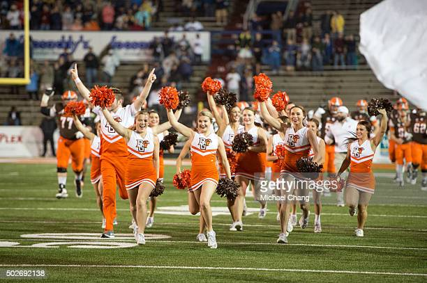 The Bowling Green Falcons cheerleaders run out on to the field prior to their game against the Georgia Southern Eagles on December 23 2015 at Ladd...