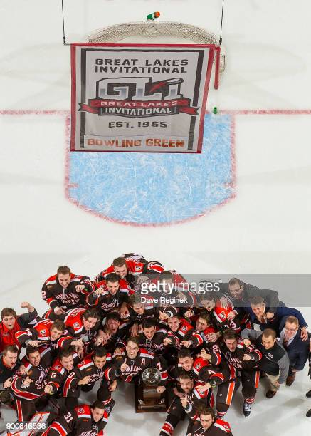 The Bowling Green Falcons watch as the team banner is raised to the rafters after winning the championship game of the Great Lakes Invitational...