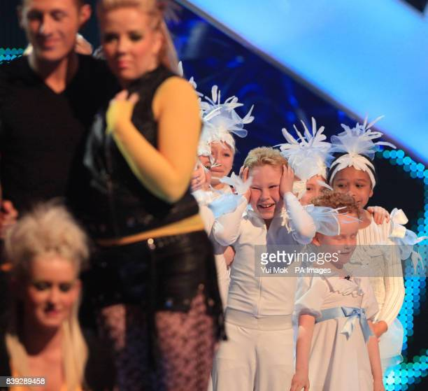 The Box celebrate after they were announced as one of the two winners of the semi-final of Sky1's Got To Dance, as losers Dance Dynamix look on . At...