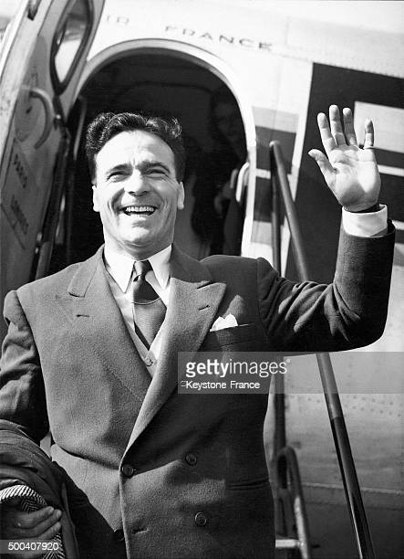 The boxing champion Marcel Cerdan arriving at London airport to fight Dick Turpin at Earl Court on March 26, 1932 in London, United Kingdom.