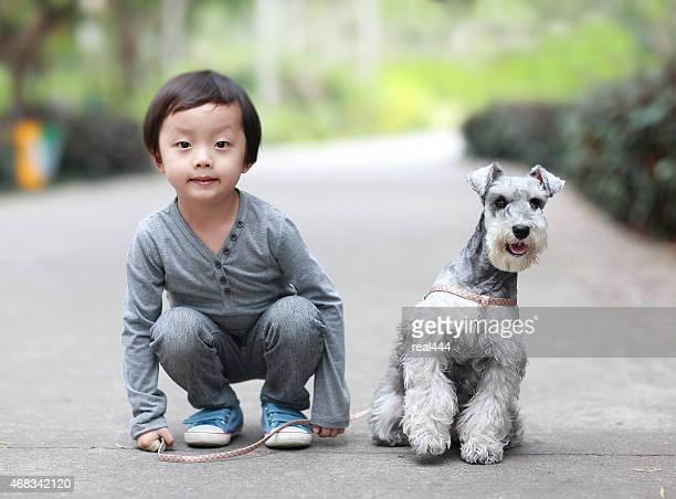 The boy and the dog in the park