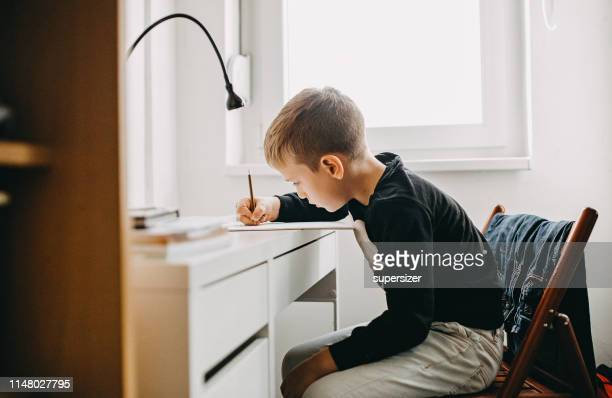 the boy is doing homework - homework stock pictures, royalty-free photos & images