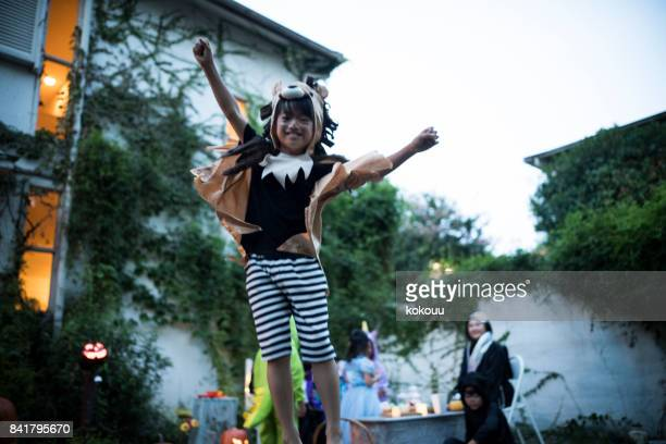the boy jumps up fine. - naughty halloween stock photos and pictures