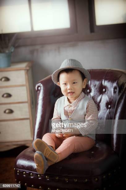 The boy sat on the sofa