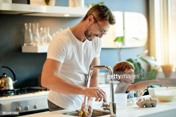 the boys are bonding - kitchen stock pictures, royalty-free photos & images