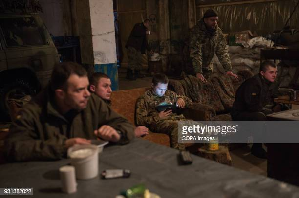 The boys of Donbass Battalion seen spending their evening in their base
