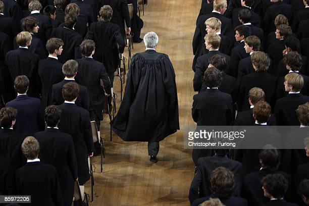The boys of Eton College stand as headmaster Tony Little arrives for morning assembly on September 6 2007 in Eton England An icon amongst private...