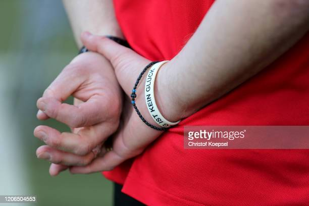 The bracelet of Steffen Baumgart of Paderborn is seen prior to the Bundesliga match between SC Paderborn 07 and Hertha BSC at Benteler Arena on...