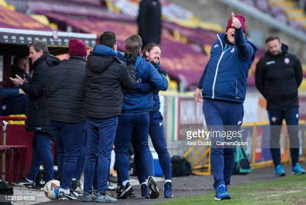 The Bradford City coaching team celebrate a very late equalising goal to make the score 1-1 during the Sky Bet League Two match between Bradford City...