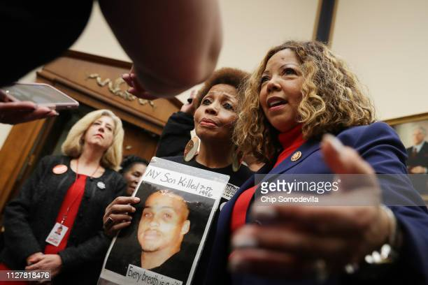 The Brady Campaign's Mattie Scott and Rep Lucy McBath both of who lost sons to gun violence pose for photographs before a hearing on gun violence...