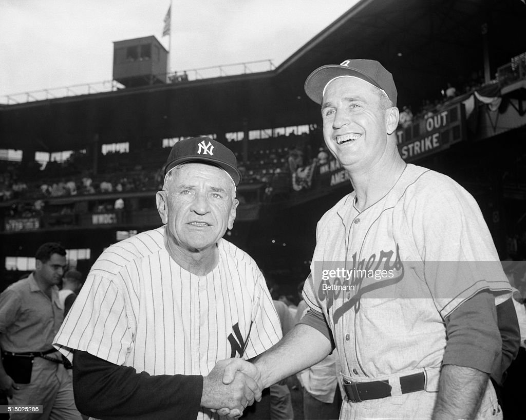 The 'Brain Departments' of the American and National League Teams meet and shake hands and wish each other luck (with tongue in cheek) just before the start of the 23rd annual all-star game. They are Casey Stengel (left), manager of the New York Yankees, who piloted the A.L Team, and Walter Alston, Dodger mentor, who steered the National Leaguers to a 7-3 victory.