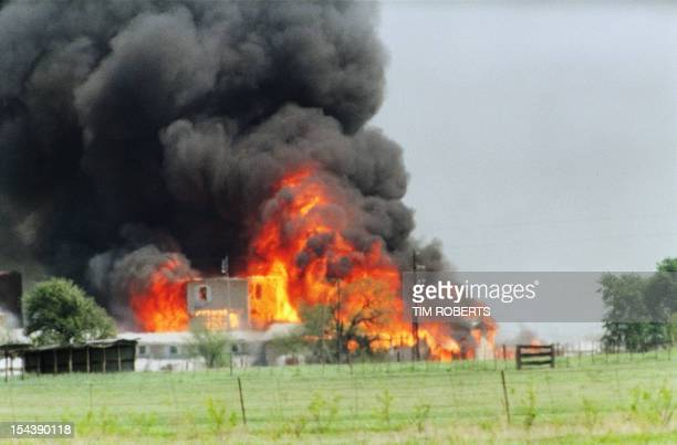The Branch Davidian cult compound observation tower in Waco, TX is engulfed in flames after a fire burns the complex to the ground 19 April 1993.
