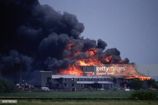 The Branch Davidians' Mount Carmel compound outside of Waco Texas burns to the ground during the 1993 raid by the Bureau of Alcohol Tobacco and...
