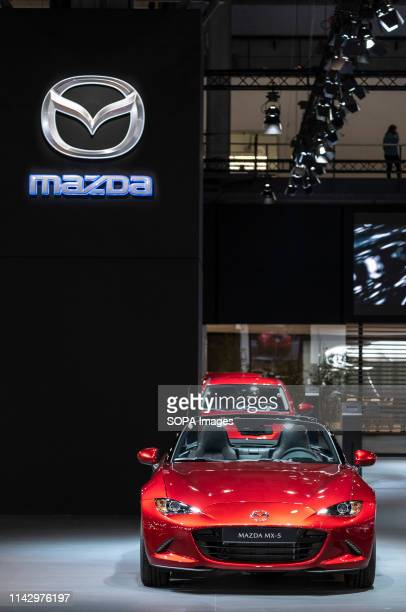 The brand logo and the new Mazda MX5 of Mazda car manufacturer seen during the event The Automobile Barcelona trade fair celebrates 100 years The...