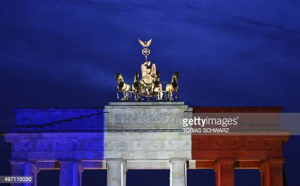 The Brandenbourg Gate featuring French national colors is pictured in Berlin on November 14 2015 a day after deadly attacks in Paris The string of...
