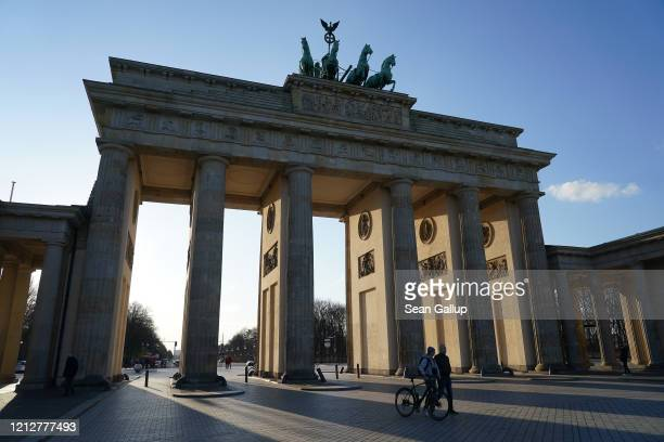 The Brandenburg Gate, a popular landmark and tourist destination, stands nearly devoid of visitors on March 16 in Berlin, Germany. Everyday life in...