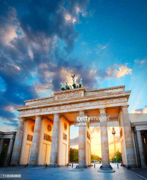the brandenburg gate and tv tower in berlin - berlin stock pictures, royalty-free photos & images