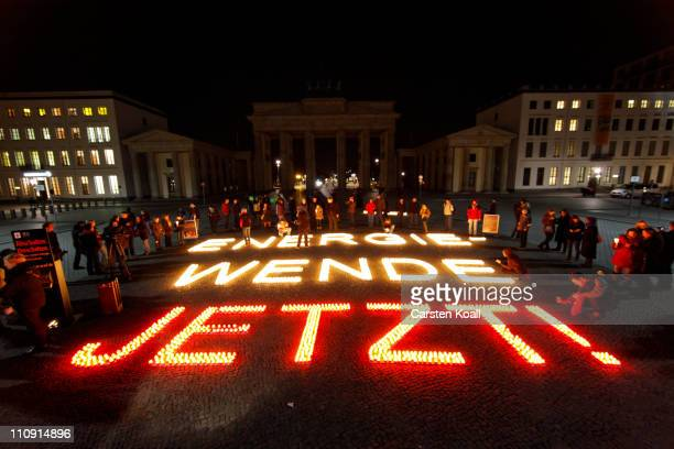 The Brandenburg Gate is seen after the lights are switched off for Earth Hour on March 26 2011 in Berlin Germany Earth Hour encourages individuals...