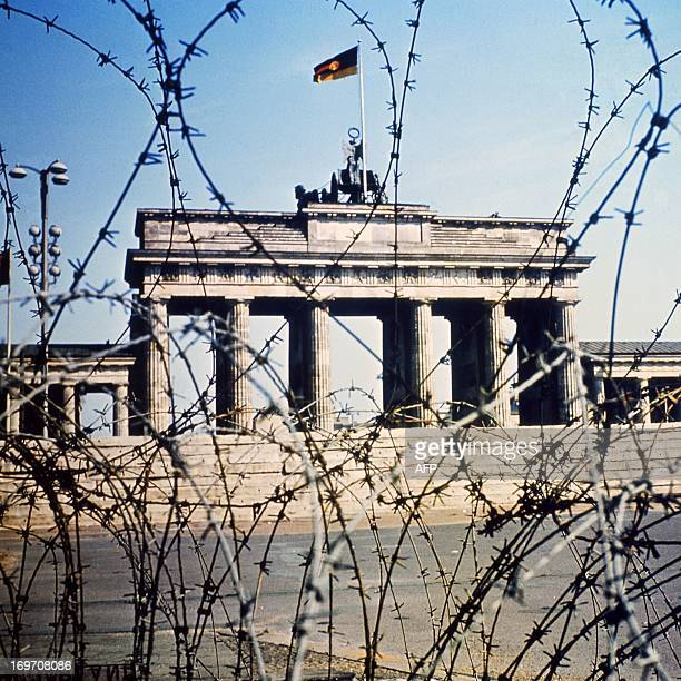 The Brandenburg Gate is seen through a barbed wire fence in June 1968 The berlin wall was built by the East German government to seal off East Berlin...