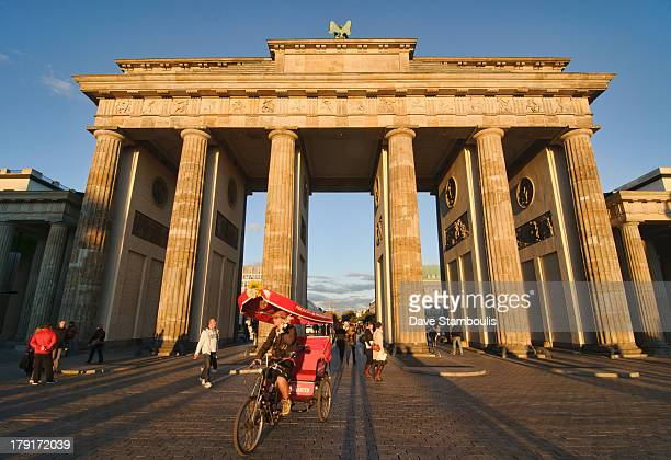 The Brandenburg Gate, landmark and icon of Berlin, Germany, lit up at sunset