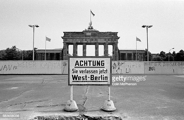 The Brandenburg Gate pictured in 1985 during the Cold War era when the Berlin Wall divided the city Germany and Europe The Wall was torn down in 1989...