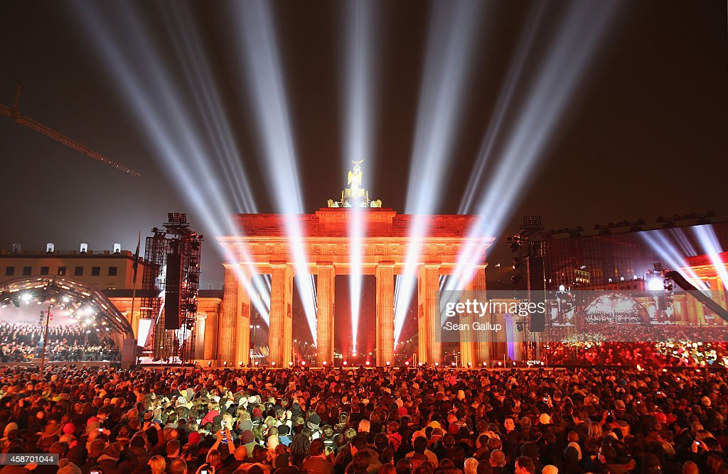 The Brandenburg Gate stands illuminated during celebrations on the 25th anniversary of the fall of the Berlin Wall on November 9, 2014 in Berlin, Germany. The city of Berlin is commemorating the 25th anniversary of the fall of the Berlin Wall with an installation of 6,800 lamps coupled with illuminated balloons along a 15km route where the Wall once ran and divided the city into capitalist West and communist East. The fall of the Wall on November 9, 1989, was among the most powerful symbols of the revolutions that swept through the communist countries of Eastern Europe and heralded the end of the Cold War. Built by the communist authorities of East Germany in 1961, the Wall prevented East Germans from fleeing west and was equipped with guard towers and deadly traps.