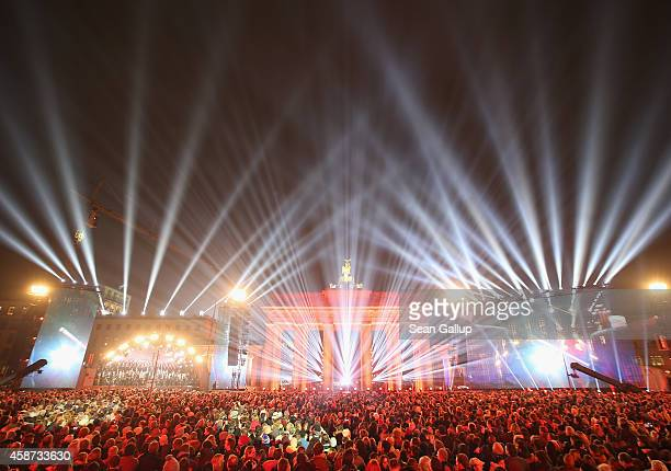 The Brandenburg Gate stands illuminated during celebrations on the 25th anniversary of the fall of the Berlin Wall on November 9 2014 in Berlin...