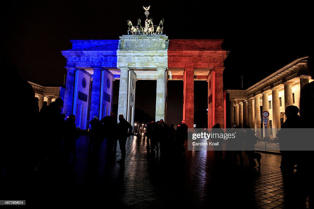 The Brandenburg Gate stands illuminated in the colors of the French flag nearby the French Embassy following the recent terror attacks in Paris on November 15, 2015 in Berlin, Germany. Hundreds of people came throughout the day to lay flowers, candles and messages of condolence to mourn the victims of attacks last friday night in Paris that left at least 160 people dead across the French capital. The Islamic State (IS) has claimed responsibility for the attacks that were carried out by at least eight terrorists.