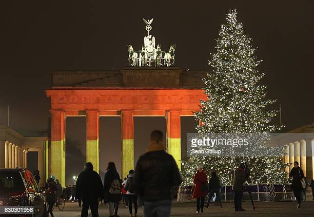 The Brandenburg Gate stands illuminated in the colors of the German flag the day after a truck drove into a crowded Christmas market in the city...