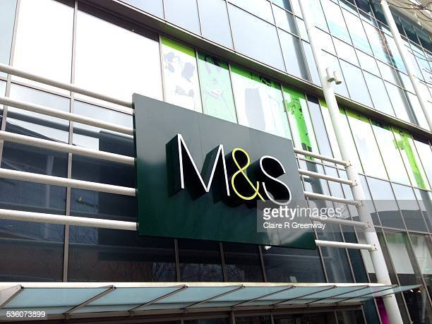 The branding on the shop front of a branch of clothing food and home furnishings retailer Marks and Spencer is pictured