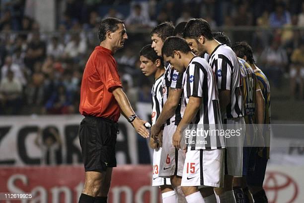 The Brasilian referee Salvio Fagundes Filho gestures to the Libertad players, in the Santander Libertadores 2011 Cup at Nicolas Leoz Stadium on April...