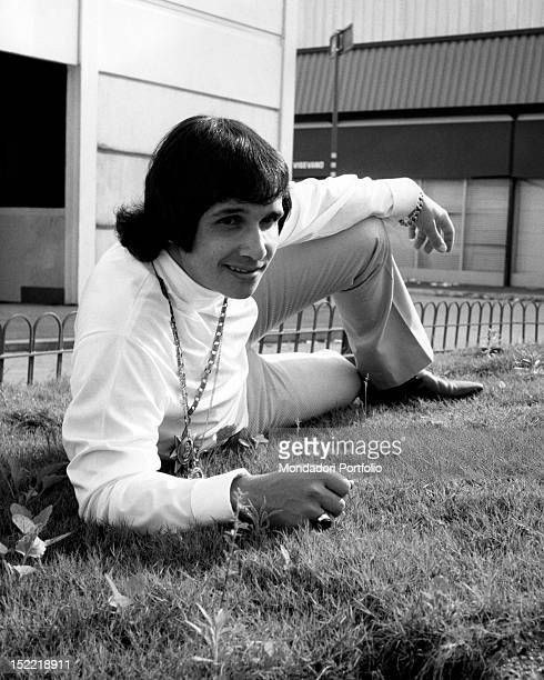 The Brasilian singer Roberto Carlos is posing lying on a flowerbed during a stay in Milan Milan July 1968