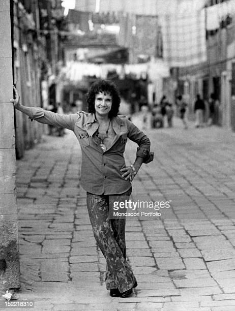 The Brasilian singer Roberto Carlos is posing with his hand leant against the wall in a street the singer starts his career in 1958 as imitator of...
