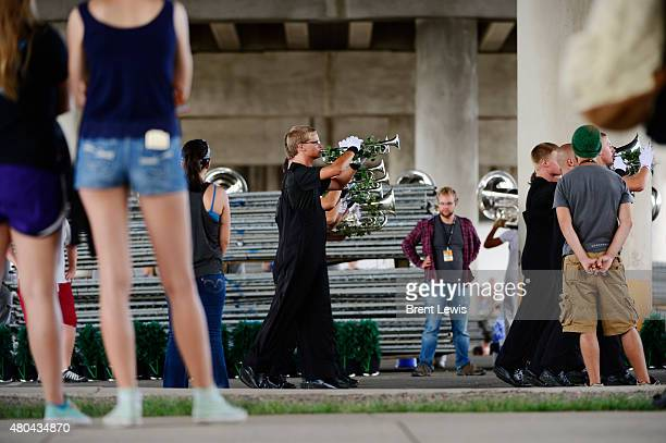 The brass section for the Mandarins from Sacramento CA practice Saturday July 11 2015 at Sports Authority Field At Mile High Stadium in Denver...