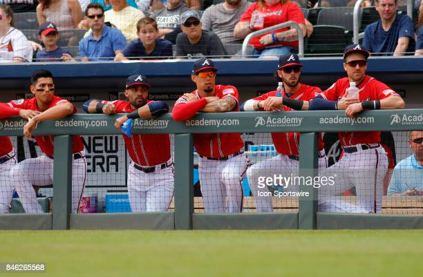 The Braves line the dugout rail during the major league baseball game between the Atlanta Braves and the Miami Marlins on September 10 at SunTrust...
