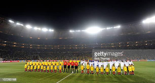 The Brazil and Ivory Coast teams line up before the start of the 2010 FIFA World Cup South Africa Group G match between Brazil and Ivory Coast at...