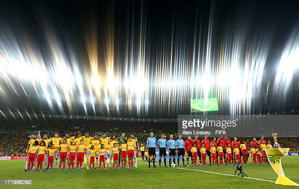 The Brazil and Spain players lineup for the anthems prior to the FIFA Confederations Cup Brazil 2013 Final match between Brazil and Spain at Maracana...