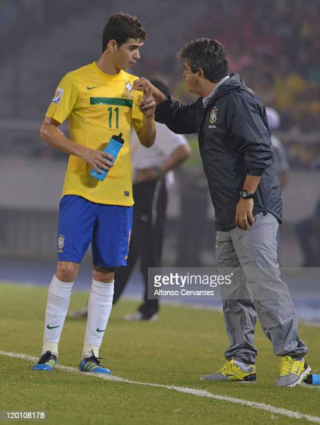The Brazil coach Ney Franco gives instructions to his midfielder Oscarduring a match between Brazil and Egypt as part of the FIFA U20 World Cup...