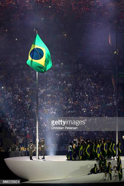 The Brazil flag is raised during a performance at the Opening Ceremony of the Rio 2016 Olympic Games at Maracana Stadium on August 5 2016 in Rio de...