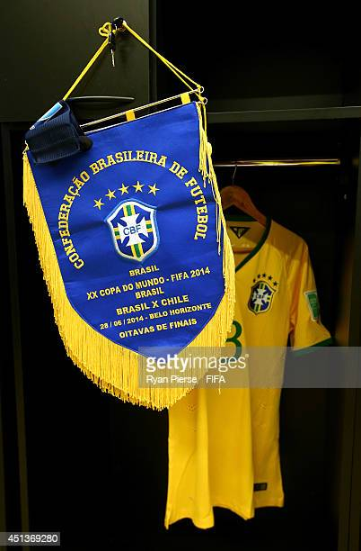 The Brazil match pennant hangs in the dressing room prior to the 2014 FIFA World Cup Brazil Round of 16 match between Brazil and Chile at Estadio...
