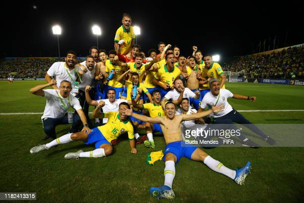 The Brazil players and staff celebrate at the end of the FIFA U17 World Cup Brazil 2019 semifinal match between France and Brazil at Estadio Bezerrao...