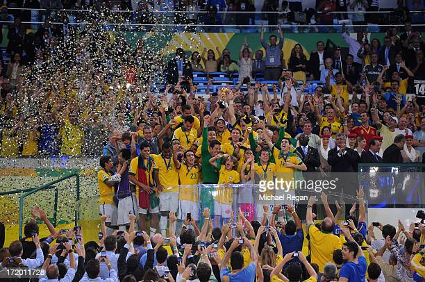 The Brazil players celebrate with the trophy following their victory at the end of the FIFA Confederations Cup Brazil 2013 Final match between Brazil...