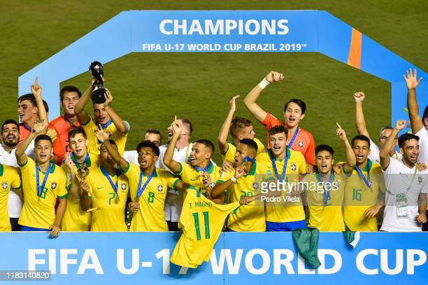 The Brazil side celebrate with the World Cup Trophy after winning during the Final of the FIFA U17 Men's World Cup Brazil 2019 final match Mexico and...