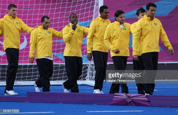 The Brazil team arrive for their gold medals after defeating France in the gold medal match during the 5 aside Football on day 10 of the London 2012...